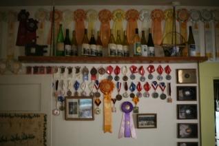 A wall inside showcasing awards.